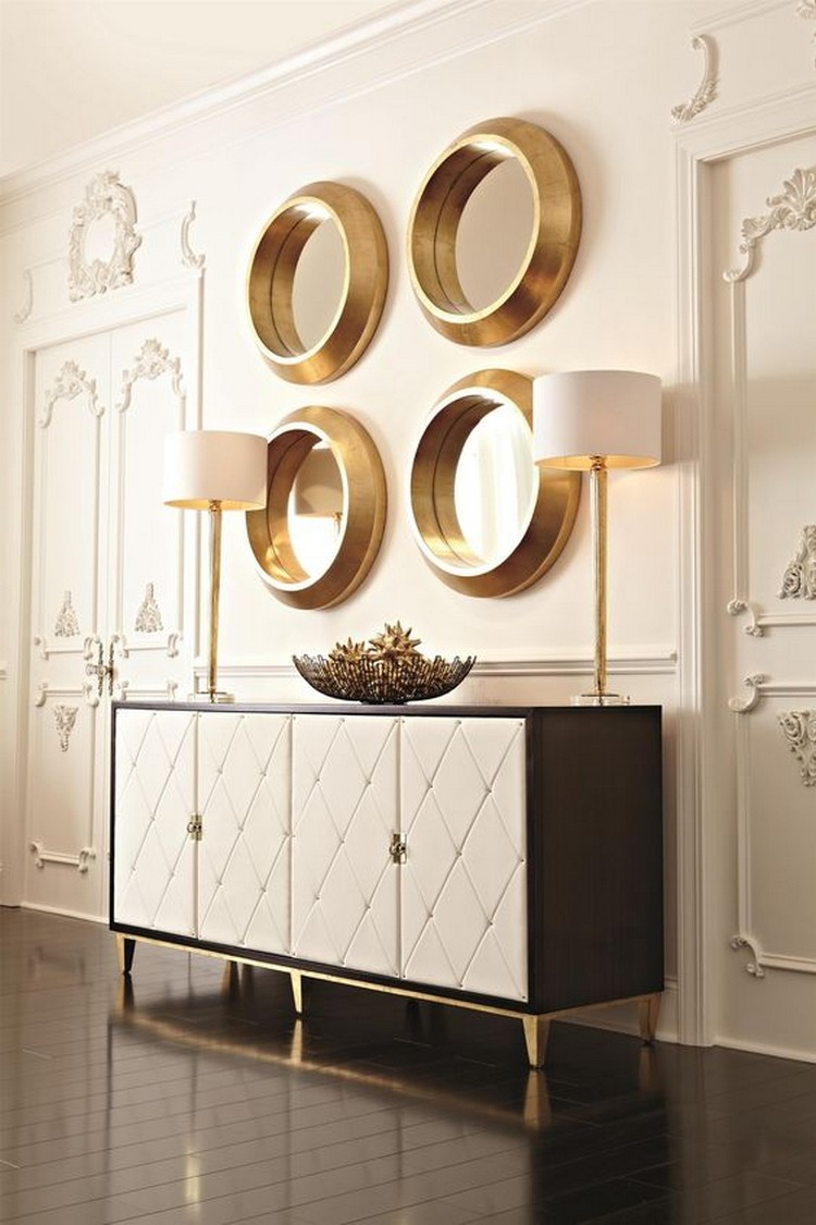 JET SET BUFFET BY BERNHARDT - Buffet with stripe sapele veneers and caviar finish with gold finish base. It has four wrapped doord quilted in white bonded leather with nailhead.