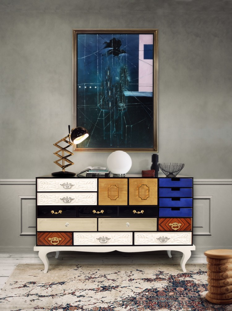 FOCAL ART - In so many credenza styling pictures, you'll see a very large piece of art mounted above the cabinet. Why? Because it just works. Somehow, placing a credenza beneath such a large piece of art helps to unify the art with the rest of the room. (SOHO Sideboard by Boca do Lobo))
