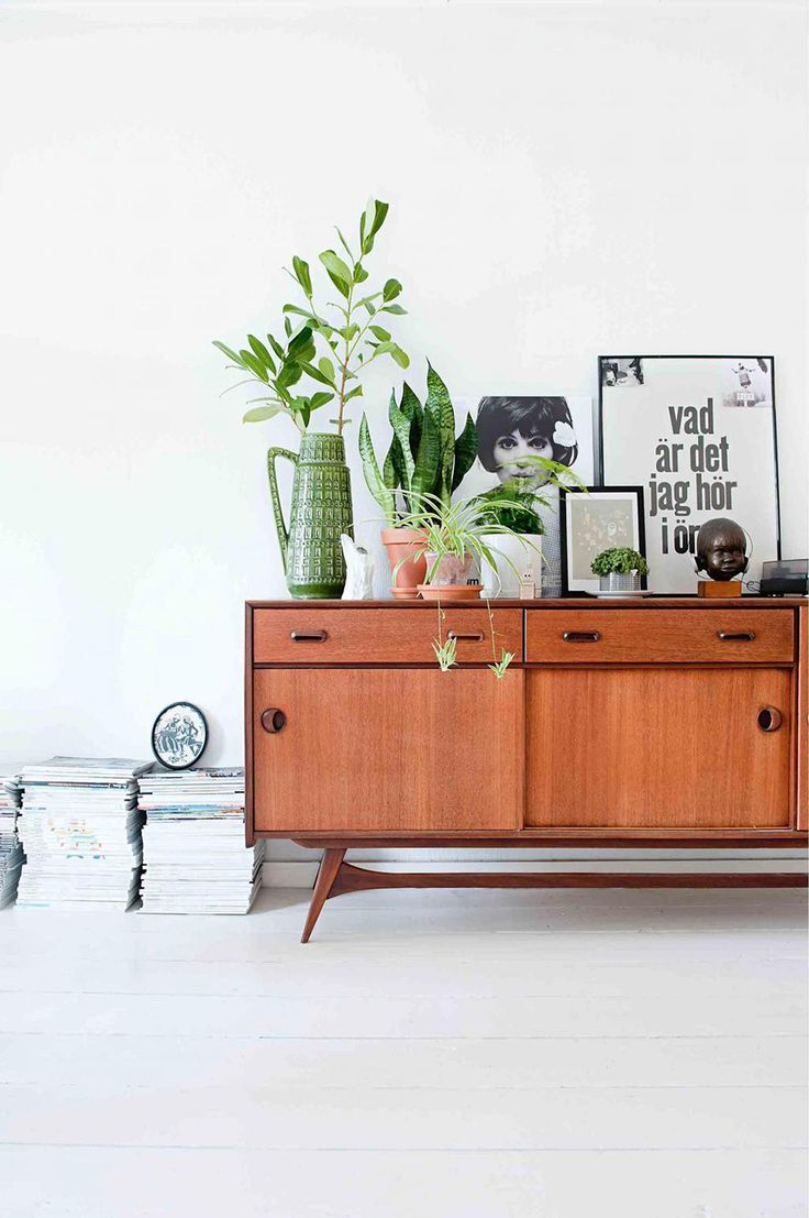 PLANT STAND - Hipster plant lovers unite for the most perfect plant stand. Yes. Simply gather those leafy greens together on a mid-century credenza and you've got the looks for that California eclectic home. buffets and cabinets 4 Secrets to Style Your Buffets and Cabinets plant stand credenza