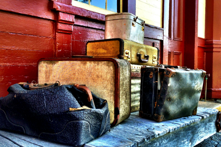 1-vintage-man-with-old-luggage-at-train-station-ryan-jorgensen